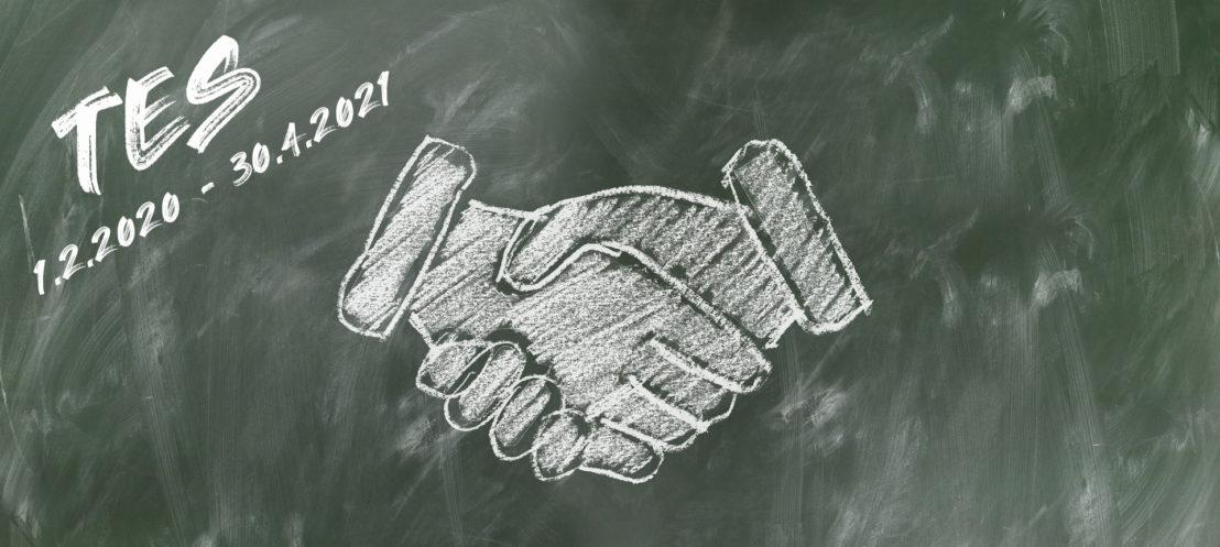 Kuvituskuva, jossa on liitutaululle piirrettynä kättelevät kädet.
