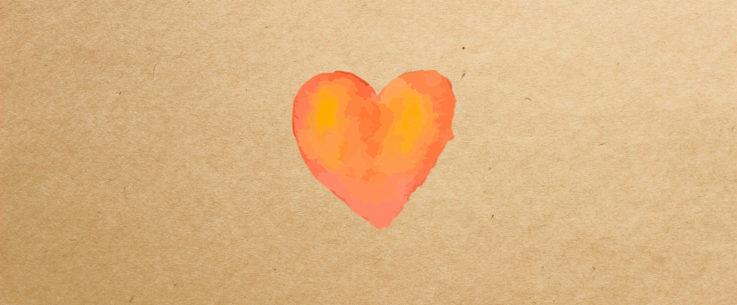 Kuvituskuva, jossa on ruskeaan paperiin maalattu oranssi sydän.