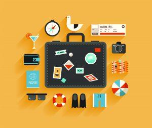 Piirretty kuva, jossa on keltaisella taustalla tummanharmaa matkalaukku, jonka ympärillä on aurinkolomalla tarvittavia esineitä, kuten aurinkolasit, räpylät ja kamera.