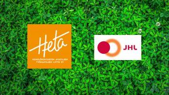 Kuvassa vihreässä taustassa kasvaa apilaa. Taustan päällä on Heta-Liiton ja JHL:n logot.